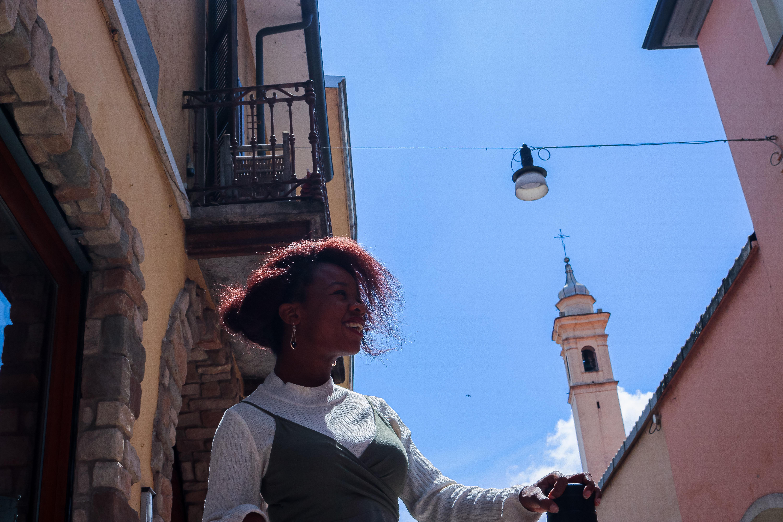 Rachy standing behind blue sky