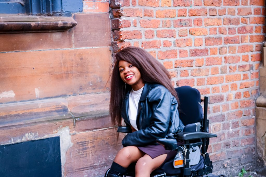 Rachy sat on wheelchair smiling