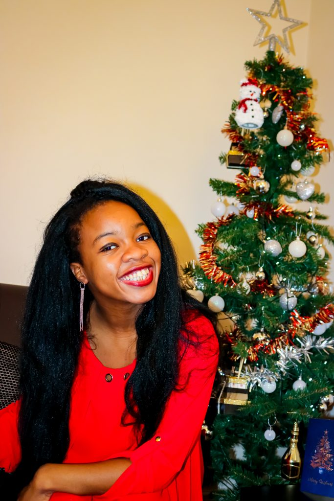 Rachy smiling by christmas tree
