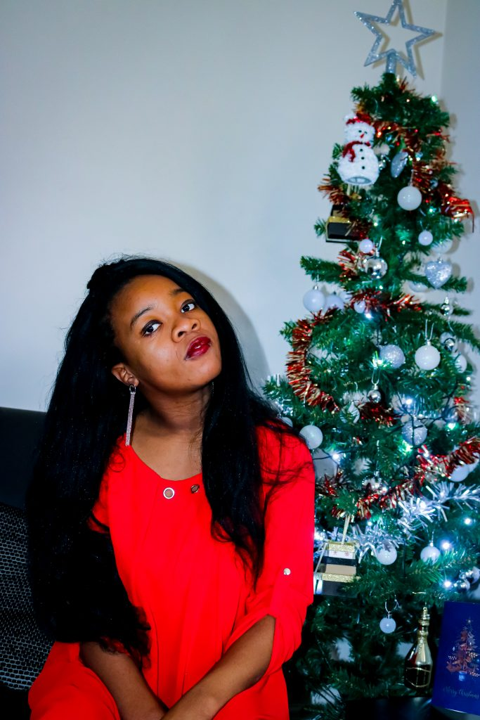 rachy sat by Christmas tree